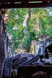 Ruins of ancient buddhist khmer temple near. Ancient stone door in ruins of  buddhist khmer temple near Siem Reap, Cambodia Stock Photo