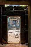 Ruins of ancient buddhist khmer temple. Ancient stone door in ruins of  buddhist khmer temple near Siem Reap, Cambodia Stock Images