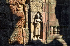 On the ruins of an ancient Buddhist temple in Cambodia. Royalty Free Stock Photos