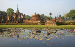 The ruins of the ancient Buddhist temple in the morning sun. Sukhothai historical Park Stock Photography