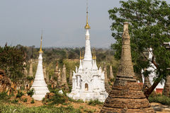 Ruins of ancient Burmese Buddhist pagodas Nyaung Ohak in the village of Indein on Inlay Lake in Shan State Royalty Free Stock Photos