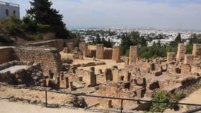 Ruins of ancient Carthage in Tunisia. People on ruins of ancient Carthage in Tunisia. Carthage is a major urban centre that has existed for nearly 3,000 years on stock video