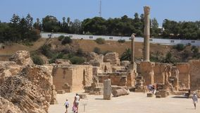 Ruins of ancient Carthage in Tunisia. People on ruins of ancient Carthage in Tunisia. Carthage is a major urban centre that has existed for nearly 3,000 years on stock video footage