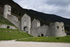 The ruins of an ancient castle fortress , walls with towers and drawbridge in south tyrol italy Royalty Free Stock Image
