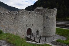 The ruins of an ancient castle fortress , walls with towers and drawbridge in south tyrol italy Stock Images