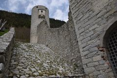 The ruins of an ancient castle fortress , walls with towers and drawbridge in south tyrol italy Royalty Free Stock Photo