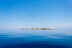 Ruins of ancient castle on the island in mediterranean sea in Croatia Royalty Free Stock Images