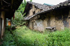 Ruins of ancient Chinese dwelling houses in weeds Royalty Free Stock Photo