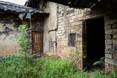 Ruins of ancient Chinese farm houses in weeds Royalty Free Stock Images