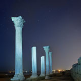 Ruins of ancient city columns under night sky stock photography
