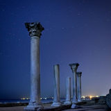 Ruins of ancient city columns under night sky Royalty Free Stock Photos