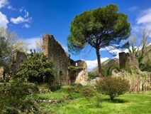 Ruins of the ancient city of Ninfa. The ruins of the old Ninfa city surrounded by the same name park. Garden of Ninfa, Province of Latina, Italy. April 2018 royalty free stock image