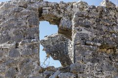 Ruins of the ancient city of Sidima, Turkey. A wall with a window opening Royalty Free Stock Photos