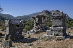 Ruins of the ancient city of Sidima, Turkey, three Lycian tombs. Against the blue sky Royalty Free Stock Image
