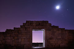 Ruins of ancient city under blue night sky Stock Images