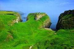 Ruins of Dunseverick Castle atop green cliffs of the Causeway Coast, Northern Ireland royalty free stock images
