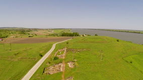 Ruins of the ancient fort of Noviodunum, aerial. Noviodunum, was a fort and a port in the Roman province of Moesia located on the lower Danube stock video