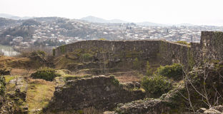 The ruins of an ancient fortress on a background of Kutaisi, Georgia Royalty Free Stock Photos