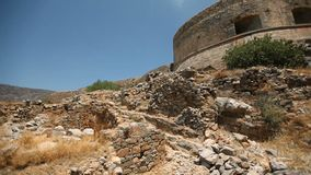 Ruins of an ancient fortress. On the island of Spinalonga against the background of the sky. Cretan island of Spinalonga, location of the last leper colony in stock video footage