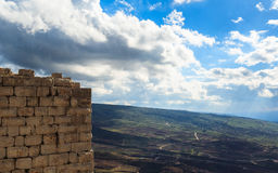 Ruins of ancient fortress, Upper Galilee, Israel. Concept: travel, history and nature. Ruins of ancient Crusader fortress, Golan Heights background, beautiful Royalty Free Stock Photo