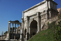 Ruins of the ancient Forum in Rome. Arch of Septimius Severus and the remnants of the Temple of Saturn in the ancient Roman Forum of Rome stock photography
