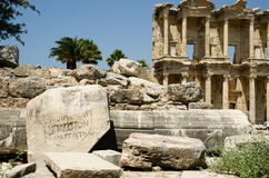 Ruins of Ancient Greek city  Ephesus. Stone slab with ancient inscriptions on the ruins of Ancient Greek city  Ephesus Royalty Free Stock Photography