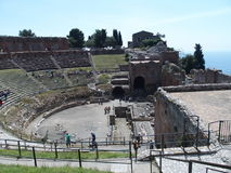Ruins of ancient greek and roman theatre in Taormina. TAORMINA, SICILY ITALY on MAY 2016: Ruins of ancient greek and roman theatre in italian city, seaside Stock Image