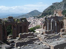 Ruins of ancient greek and roman theatre in Taormina. TAORMINA, SICILY ITALY on MAY 2016: Ruins of ancient greek and roman theatre in italian city, seaside Stock Photo