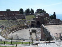 Ruins of ancient greek and roman theatre in Taormina. TAORMINA, SICILY ITALY on MAY 2016: Ruins of ancient greek and roman theatre in italian city, seaside Stock Photography