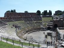 Ruins of ancient greek and roman theatre in Taormina. TAORMINA, SICILY ITALY on MAY 2016: Ruins of ancient greek and roman theatre in italian city, seaside Stock Images