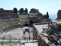 Ruins of ancient greek and roman theatre in Taormina. TAORMINA, SICILY ITALY on MAY 2016: Ruins of ancient greek and roman theatre in italian city, seaside Royalty Free Stock Image