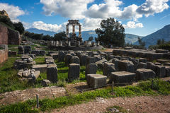 Ruins of an ancient greek temple of Apollo at Delphi, Greece Royalty Free Stock Photos