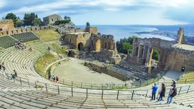 Ruins of ancient Greek theater in Taormina, Sicily, Italy. Taormina, Italy - May 15, 2018: Ruins of ancient Greek theater in Taormina, famous resort in Sicily stock footage