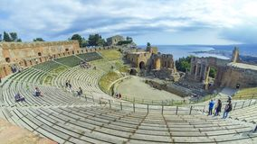 Ruins of ancient Greek theater in Taormina, Sicily, Italy. TAORMINA, ITALY - MAY 15, 2018: Ruins of ancient Greek theater in Taormina, Sicily, Italy. Coast of stock footage