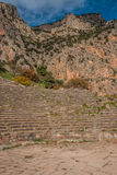 Ruins of an ancient greek theatre at Delphi, Greece royalty free stock photography
