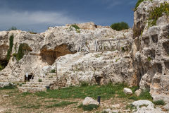 Ruins of the ancient Greek theatre in the historic centre of Syracuse Royalty Free Stock Photography