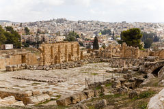 The ruins of ancient jerash. In jordan with the modern city in the background Stock Photo