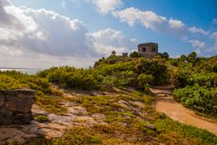 The ruins of the ancient Mayan city in the archaeological complex of Tulum. Riviera Maya, Yucatan, Mexico.  royalty free stock photos