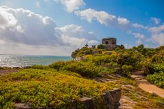 The ruins of the ancient Mayan city in the archaeological complex of Tulum. Riviera Maya, Yucatan, Mexico.  royalty free stock photography