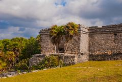 The ruins of the ancient Mayan city in the archaeological complex of Tulum. Riviera Maya, Yucatan, Mexico.  royalty free stock images