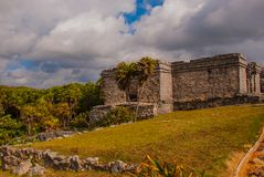 The ruins of the ancient Mayan city in the archaeological complex of Tulum. Riviera Maya, Yucatan, Mexico.  stock photo