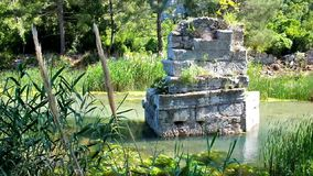 Ruins of ancient Olympos. The ruins of the ancient bridge in Akcay river in historic town of Olympos, nowadays preserved as archaeological site, located in a stock footage