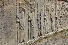 Stone bas-relief with warriors in ancient city Persepolis, Iran. Royalty Free Stock Photography
