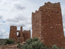 Ruins of ancient pueblos in desert canyon Royalty Free Stock Image
