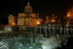 Ruins of an ancient Roman forum at night, Italy Stock Photography