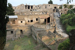 Ruins of the ancient Roman Pompei, Italy. The city of Pompeii was an ancient Roman town-city near modern Naples. Pompeii along with Herculaneum and many villas stock photography