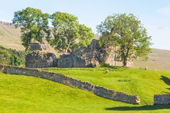 Ancient Castle Ruins in the Yorkshire Dales. The ruins of an ancient stone castle in the Yorkshire Dales in England Royalty Free Stock Image