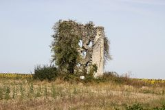 Ruins of an ancient stone fortification on a field in Central France royalty free stock photo