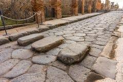 Ruins of ancient street city of Pompeii near volcano Vesuvius royalty free stock photo