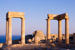Ruins of ancient temple. Temple of Athena at the top of Acropolis in ancient town Lindos, Rhodes island, Greece Royalty Free Stock Image